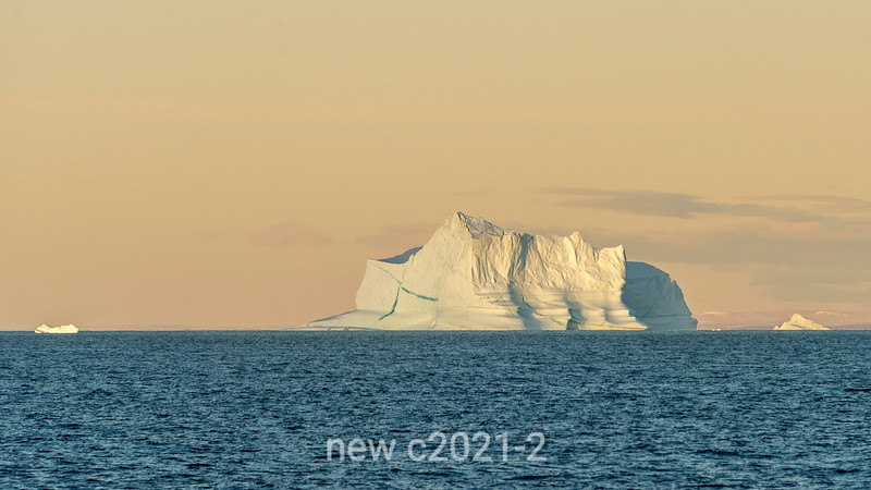 Sculptured iceberg at the opening to Scoresby Sund at sunset, East Greenland