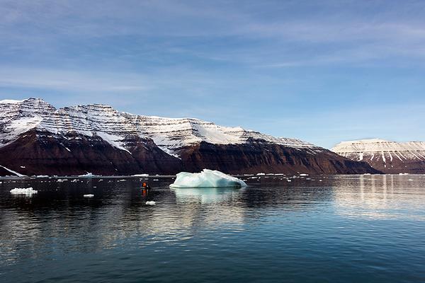 Vikingebugt Inlet with striated volcanic rocks, bergy bits and brash ice, Scoresby Sund, Greenland
