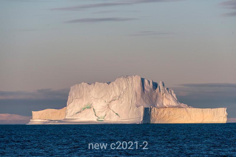 Pink iceberg at sunset