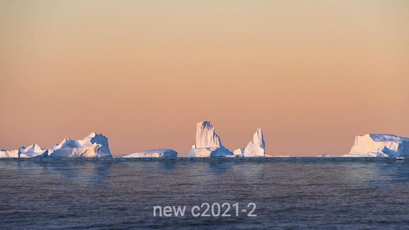 Icebergs on the horizon at sunset, Scoresby Sund, East Greenland