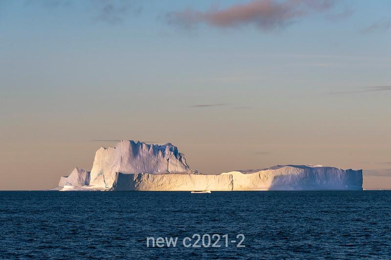 Large tabular iceberg at sunset, Scoresby Sund, East Greenland
