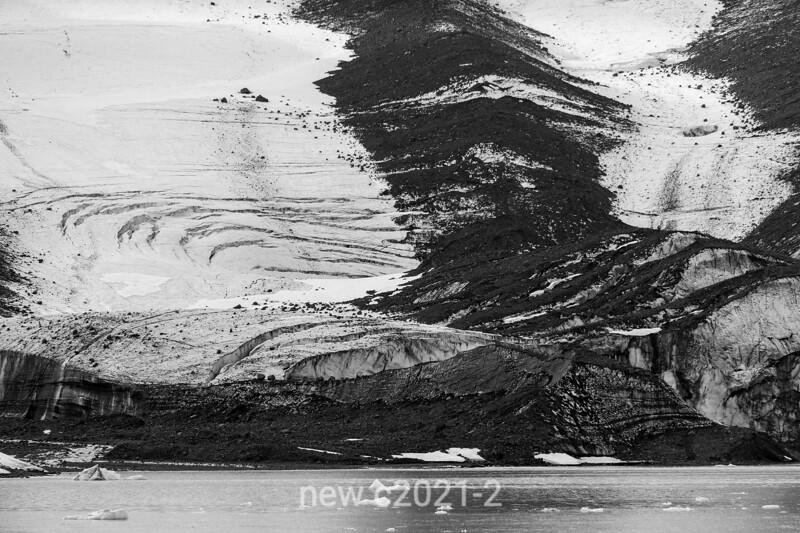 Glacial scree and crevaces, Bredegletcher, Vikingebugt Inlet, Scoresby Sund, Greenland