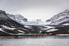Shore line and arm of the Bredegletcher glacier on a misty day, Vikingebugt Inlet, Scoresby Sund, Greenland
