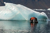 Photographers head to a small blue ice berg, Vikingebugt Inlet, Scoresby Sund, Greenland