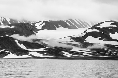 But even when reduced to black and white the rolling hills covered by snow and fog provide a dramatic picture