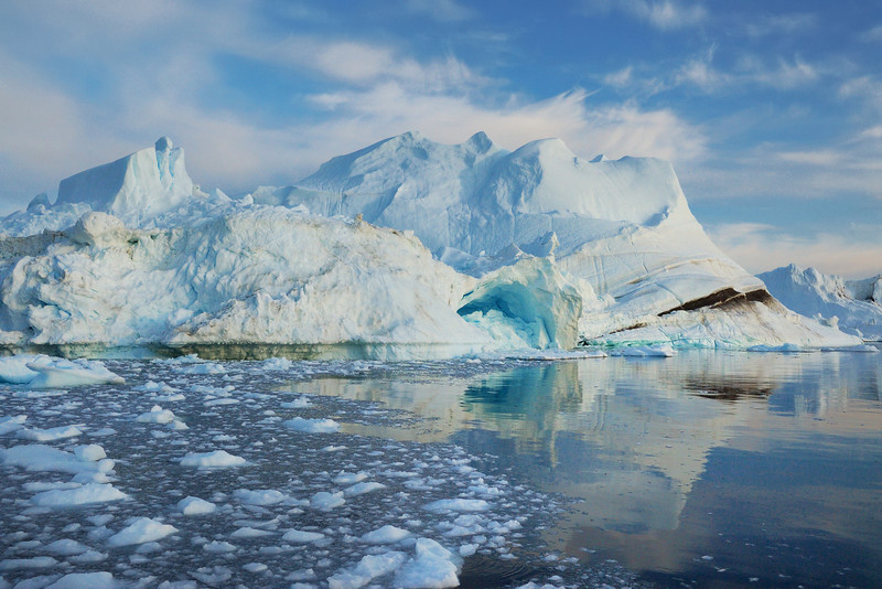The area of Ilulissat is situated in the Disko Bay in West Greenland, and is dominated by enormous icebergs produced by the Ilullisat icefjord. This region lies 300 km north of the Arctic Circle.