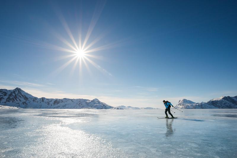 Adam Craig skating across sea ice, East Greenland