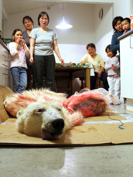 36 Polar bear hunter's family preparing to flense skin