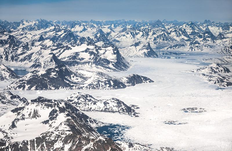 Aerial view over Ammassalik/Tuno region. Storebror visible top left, East Greenland