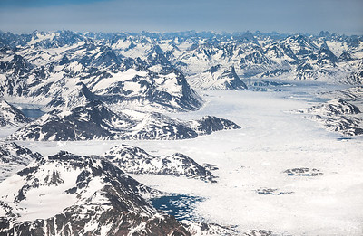 Aerial view over Ammassalik/Tuno region. Storebror visible top left, East Greenland