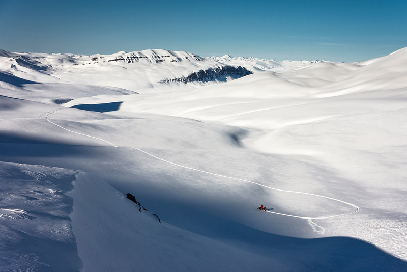 Snowmobiling above Pingel Dal, East Greenland
