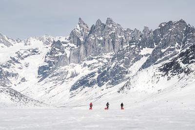 Dragging pulks across the sea ice towards Storebror, East Greenland