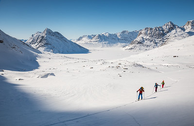 Misha, Toto and Stuart skinning up to a new line, East Greenland