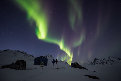 Aurora Borealis over Hunter's cabin, East Greenland