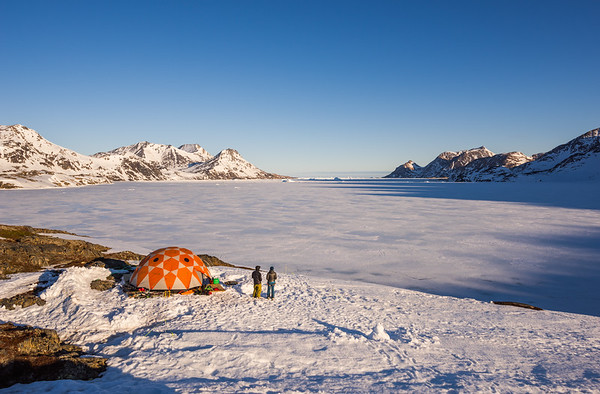 Pete and Bethan and Base Camp at sunset, East Greenland
