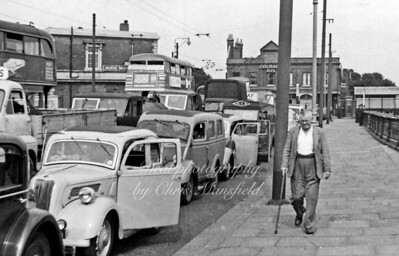 1955.  Ferry queue in North Woolwich