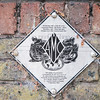 Sept' 27th 2016.  AMC plaque on a wall in Maxey road