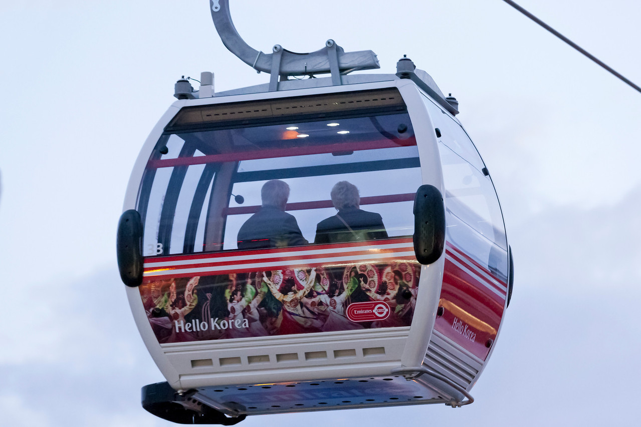 Close up of the back of a cable car with passengers.