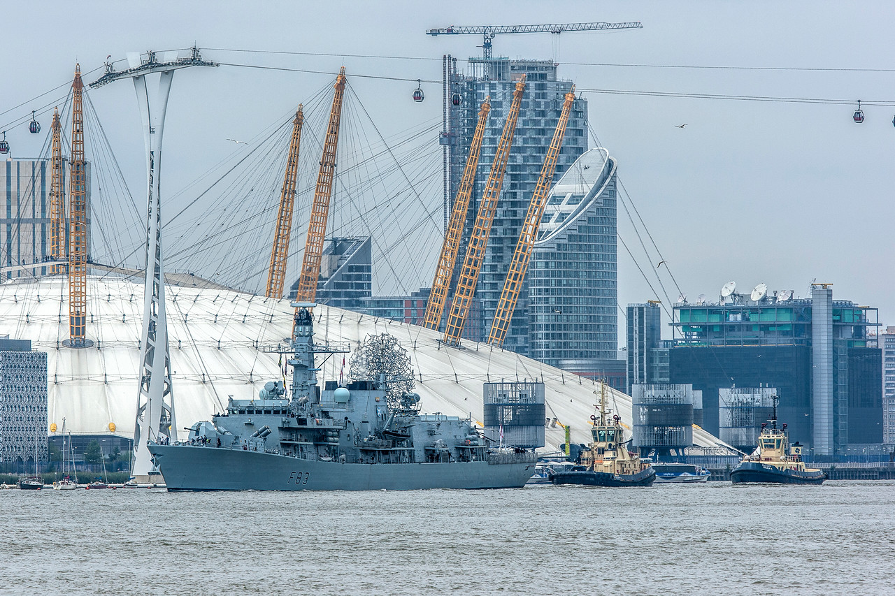 HMS St Albans Frigate sails past the O2 Arena in London's Docklands