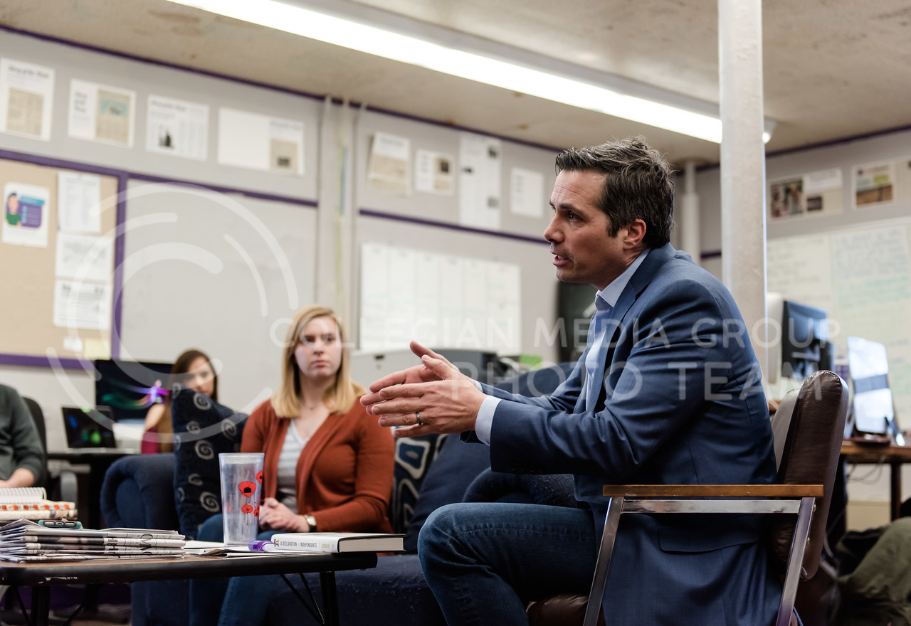 Hands up and speaking brightly about Kansas's future, independent candidate for the governer's office Greg Orman tells the staff of the K-State Collegian Newspaper on Friday about his ideas and plans for his governacy. (Olivia Bergmeier | Collegian Media Group)