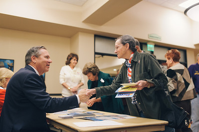 LAGUNA WOODS, CALIF. - Congressional candidate Greg Raths shakes hands with a voter of California's 45th district March 24. Raths, a retired U.S. Marine Col., spoke on policies regarding veteran benefits, education, healthcare and the economy. (Photo by Tommy Huynh)