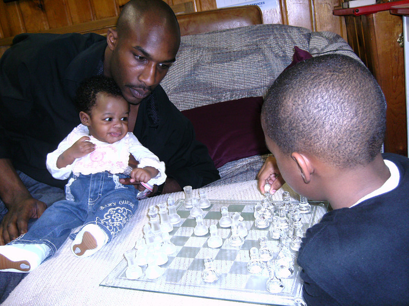 My daddy thinks it's time for me to learn how to play chess.