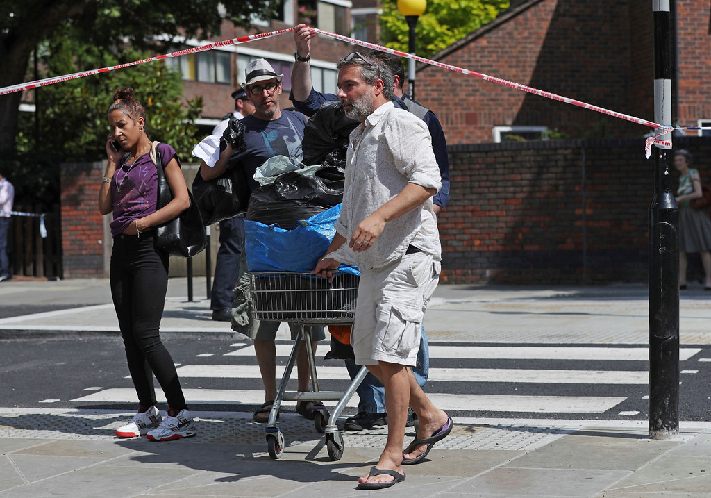 . Members of the public bring supplies to Notting Hill Methodist Church to assist people affected by a fire that engulfed the Grenfell Tower, a high-rise apartment building on fire in west London Wednesday, June 14, 2017. Fire swept through the high-rise apartment building early Wednesday, sending dozens people to area hospitals. (Jonathan Brady/PA via AP)