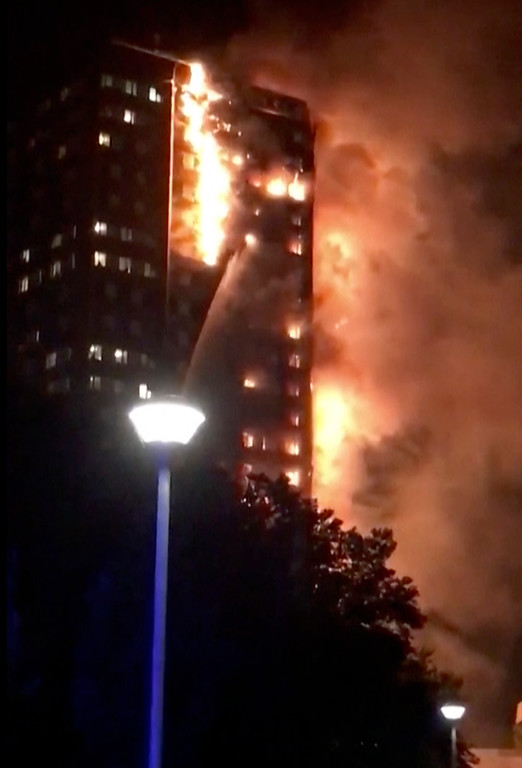 . In this image made from video provided by Celeste Thomas @MAMAPIE, a building is on fire in London, Wednesday, June 14, 2017. Firefighters are battling a massive fire in an apartment high-rise in London. One side of the building appeared to be in flames. (Celeste Thomas @MAMAPIE via AP)