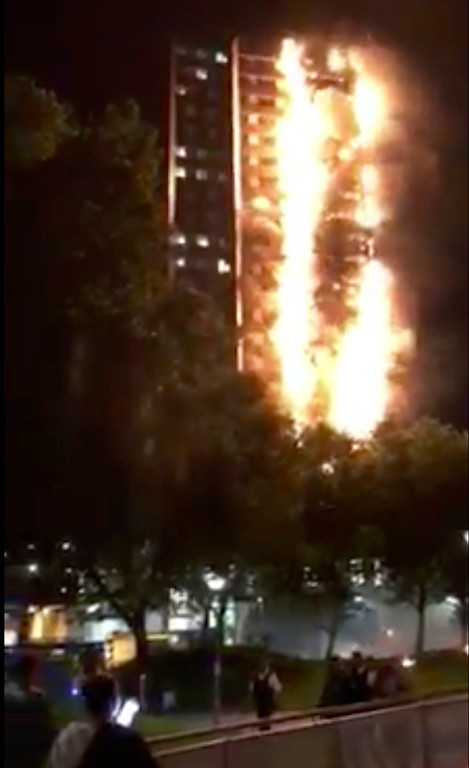 . In this image made from video provided by Mischa Saag, a building is on fire in London, Wednesday, June 14, 2017. Firefighters are battling a massive fire in an apartment high-rise in London. (Mischa Saag via AP)