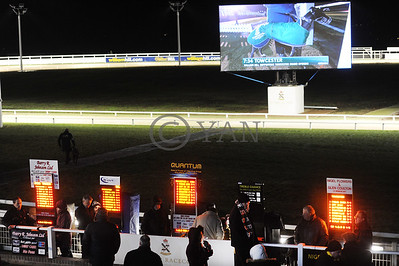 Late night for the bookies. Time on the big screen says 7.34, but this is the scene when the first race, earlier voided, eventually went off at a time nearer to 11 pm! Towcester 13th December 2014. Photo: Steve Nash