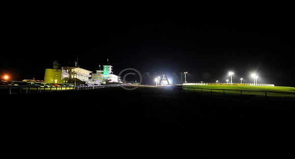 The view of Towcester grandstand and greyhound track (right) from the horseracing course, on the opening night. 6th December 2014. Photo: Steve Nash