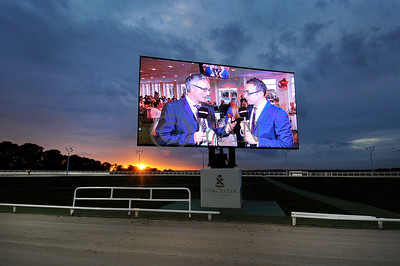 Hobsy and Enzo on the big screen -TV Trophy night Sky coverage. Towcester 18th August 2015. Photo Steve Nash