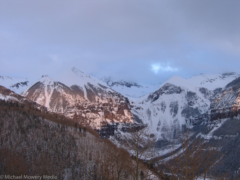 This is a typical site in Telluride, where the sun decends to the level of the clouds and the tops of the peaks are in shadows.  I could tell that this had the possiblity of a good sunset, once the sun was shinning below the clouds.