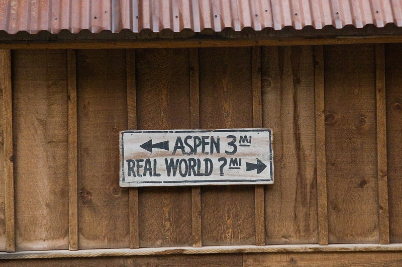 Aspen or Real World Sign on building in Telluride