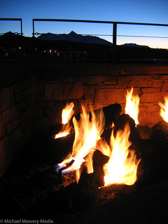 Outside fire at the Peaks hotel with Wilson Peak in background.
