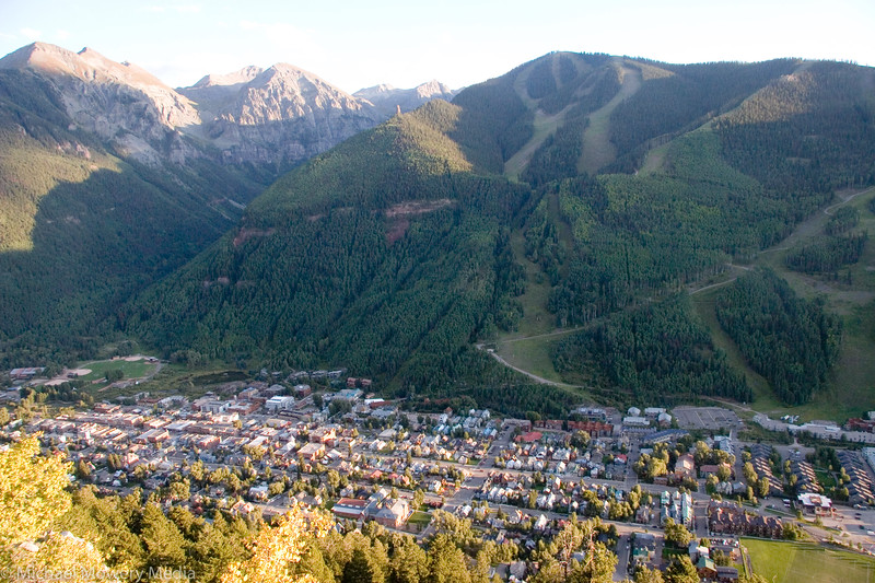 Compact town of Telluride and front side of ski area as seen from the Jud.