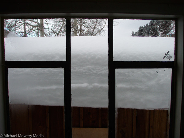 Snow on the shed outside our window