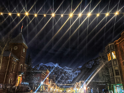 I don't always take my #photooftheday #day335  15 minutes past midnight ( check the clock tower ) but when I do it's using #nightshot under a #full #moon and under a strand of #holiday #lights .  I was at the office late getting my $500 order of MMM product before end of #cybermonday .  #telluride #colorado .  Ps. Zzzzzz