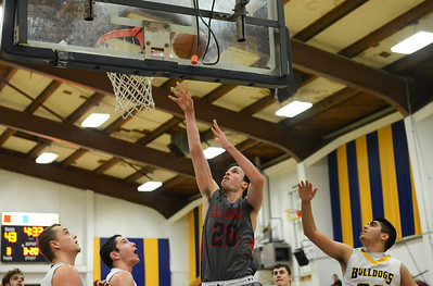 Las Plumas' Chad Auletta (20) scores as Gridley beats Las Plumas on the basketball court Friday, Feb. 3, 2017, in Gridley, California.  (Dan Reidel -- Enterprise-Record)