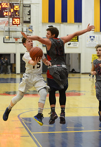 Grildey's Randy Miller (15) sneaks under Las Plumas guard Ace Hindman's defense to score as Gridley beats Las Plumas on the basketball court Friday, Feb. 3, 2017, in Gridley, California.  (Dan Reidel -- Enterprise-Record)