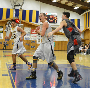 Tyler Little, center, screams as he comes down with a rebound as Gridley beats Las Plumas on the basketball court Friday, Feb. 3, 2017, in Gridley, California. Gridley's Brandon Lara, left, and Las Plumas' Sullivan Hurte, right, head upcourt as Little secures the rebound. (Dan Reidel -- Enterprise-Record)