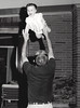 1960s CO Family Bill tossing Tracee at the Grigsbys on Yale St in BW