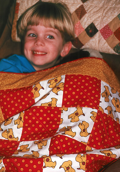 1996/12 Ben with multiple quilts