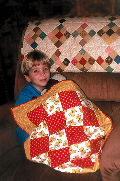 1996 12 Ben in Houston under a couple quilts