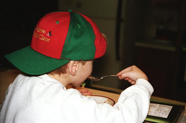 1996 TX Ben eating in the Santa hat