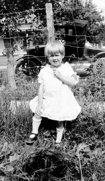 1924/07 - This photo shows Phyllis Grigsby when she was about 3.  It might have been taken in July 1924 for her 4th birthday.  The picture is especially interesting because Bill believes the car parked behind Phyllis is Will Grigsby's 1912 or 1913 Buick that dad described as being used by his father to deliver mail.  I also believe the house behind Phyllis in this picture resembles the house where dad was born.  So Bill guessed the picture was taken in front of Will and Lida Grigsby's house in Williamsburg, KS.