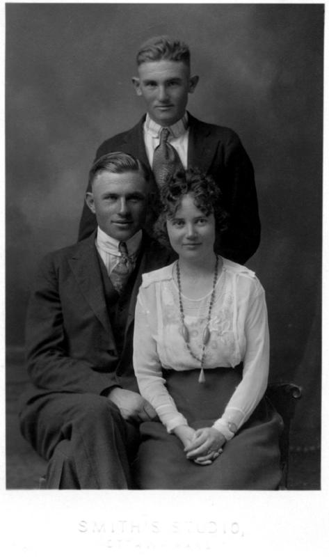 "1918 - Theodore, Josie and Walter:  Photo provided by Donald Grigsby (Theodore's third son).  This is the wedding photograph of William Theodore Grigsby and Josie Sweetwood in 1918.  Uncle Walter (who played catcher for the Williamsburg town team according to Dad) was his brother's ""best man.""  Uncle Walter was born March 30, 1900 and Uncle Theodore was born on August 12, 1898.  Uncle Charles was the oldest of the siblings being born on October 20, 1896.  Hildreth Leota Grigsby was born on May 31, 1907 and James Maurice Grigsby was born on May 22 1910."