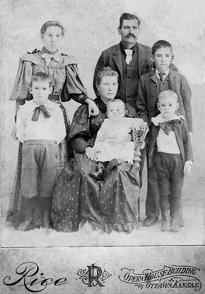 1894 - Dad wrote on the back of this photograph that it was made in about 1894 (2 years before Lida Alma married William Redman Grigsby).  In the back row are (left to right): Lida Graves, George S. Graves and Charles Graves.  In the front row are: Ezra Graves, Eva Hester Graves, Bruce Graves on Eva's lap, and Fred Graves.  Charles is the son who was killed by lightening -- he was married and living in a farm house not too far from Williamsburg when the accident happened.  Dad said the lightning hit a wire on a tree that was strung to the house.  The lightening followed the wire and struck Charles who was standing on the porch watching the storm.