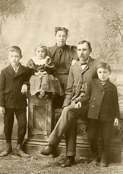 1896 - This photograph of David Warren Hester's family was taken in about 1895 or 1896 probably around Rexford or Colby, Kansas.  The photograph shows from left to right David's son Robert Ethelbert, daughter Anna Alice, wife Sarah Alice Lucas Hester, David and son Harry.  The photograph was provided by David's great grand daughter, Patricia Ruth Lane Partridge.  Murry restored the scan of Tricia's original photograph to give this terrific image of the life and times around Rexford, Kansas where this family was identified in the 1900 census.  David, born in Ohio, had been identified in the 1880 census living with his parents, John A. P. and Amanda Hester and farming near Lebanon, Kansas.