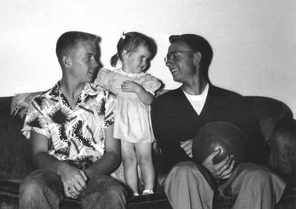 1953 - Murry,Terry and Bill:  Terry Ann Miers, Bud and Ann Mier's first child, entertains us at mom and dad's in South Denver on one of their trips from Wichita, Kansas.  Terry still is a vivacious, friendly neice!